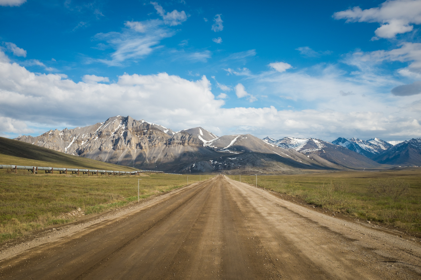 Peaks of the southern Brooks Range highlight the scenery along this stretch of the Dalton Highway